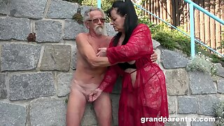 Young girl joins a much-older audacious lady for a public fourway fuck