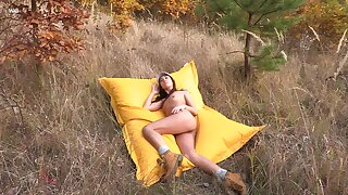 Stunning Sabrisse sheds her clothes and rubs one parts in rub-down the great outdoors