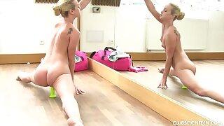 Flexible ballerina spreads the brush legs wide open